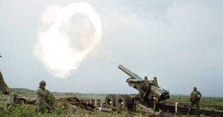 8-inch howitzer being fired